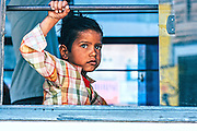 A child looks out of the window of a bus in Jodhpur, Rajasthan