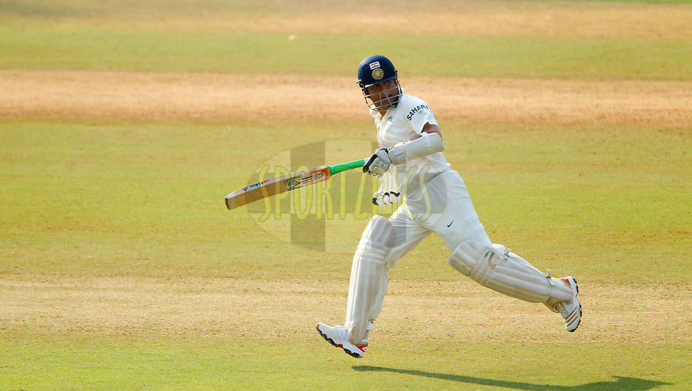 Sachin Tendulkar of India  during day one of the second Star Sports test match between India and The West Indies held at The Wankhede Stadium in Mumbai, India on the 14th November 2013<br /> <br /> This test match is the 200th test match for Sachin Tendulkar and his last for India.  After a career spanning more than 24yrs Sachin is retiring from cricket and this test match is his last appearance on the field of play.<br /> <br /> <br /> Photo by: Ron Gaunt - BCCI - SPORTZPICS<br /> <br /> Use of this image is subject to the terms and conditions as outlined by the BCCI. These terms can be found by following this link:<br /> <br /> http://sportzpics.photoshelter.com/gallery/BCCI-Image-Terms/G0000ahUVIIEBQ84/C0000whs75.ajndY