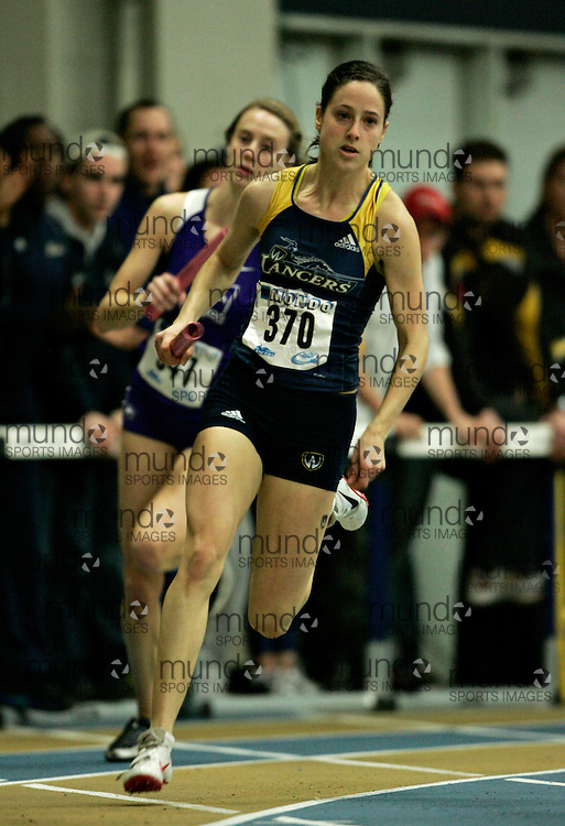 (Windsor, Ontario---13 March 2010) Noelle Montcalm of University of Windsor Lancers  competes in the women's 4 X 200 meters at the 2010 Canadian Interuniversity Sport Track and Field Championships at the St. Denis Center. Photograph copyright GEOFF ROBINS/Mundo Sport Images. www.mundosportimages.com
