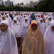 Eid Praying, Victoria Park, HK by Asti Maria.<br />