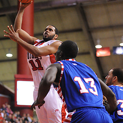 Jan 31, 2009; Piscataway, NJ, USA; Rutgers guard Earl Pettis (11) takes a shot over defender DePaul center Mac Koshwal (13) during the second half of Rutgers' 75-56 victory over DePaul in NCAA college basketball at the Louis Brown Athletic Center