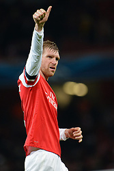 26.11.2013, The Emirates Stadium, London, ENG, UEFA CL, FC Arsenal vs Olympique Marseille, Gruppe F, im Bild Arsenal's Per Mertesacker salutes the fans // Arsenal's Per Mertesacker salutes the fans during UEFA Champions League group F match between FC Arsenal and Olympique Marseille at the The Emirates Stadium in London, Great Britain on 2013/11/26. EXPA Pictures © 2013, PhotoCredit: EXPA/ Mitchell Gunn<br /> <br /> *****ATTENTION - OUT of GBR*****