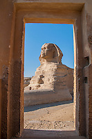 View of the Sphinx through a door. In Giza, Egypt.