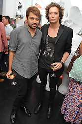 Left to right, PAPBLO GANGULI and TOMAS AUKSAS at the after party for the press night of 'As I Like It' held at the home of Amanda Eliasch, 24 Cheyne Walk, London on 5th July 2011.