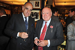 Left to right, the Swiss Ambassador to the UK HE Mr Alexis Lautenberg and JULIAN BOARD at a party to celebrate the publication of Maryam Sach's novel 'Without Saying Goodbye' held at Sotheran's Bookshop, 2 Sackville Street, London on 10th November 2009.