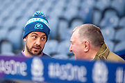 Greg Laidlaw (#21) of Scotland speaks with former Scotland player Ian McLauchlan during the Captain's training run for Scotland at BT Murrayfield, Edinburgh, Scotland on 8 March 2019 ahead of the Guinness 6 Nations match against Wales.