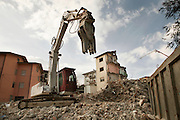 A building damaged during the earthquake are demolished. On 6 April 2009 a strong earthquake hit the city of L'Aquila, in the central Abruzzo region of Italy, leaving 308 dead and tens of thousand homeless. 4  years after In the historical center of the city few signs of reconstructions could be seen. On the other hand the effects of the of abandonment add up to the destruction of the quake. .