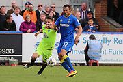 AFC Wimbledon defender Darius Charles (32) battles for possession with Peterborough United midfielder Callum Chettle (23) during the EFL Sky Bet League 1 match between AFC Wimbledon and Peterborough United at the Cherry Red Records Stadium, Kingston, England on 17 April 2017. Photo by Matthew Redman.