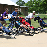 There were wheelchair races every half hour Saturday during the Arc in the Park event at the Oren Dunn Museum