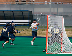 Virginia midfielder Brian Carroll (36) shoots against Navy.  The Virginia Cavaliers scrimmaged the Navy Midshipmen in lacrosse at the University Hall Turf Field  in Charlottesville, VA on February 2, 2008.