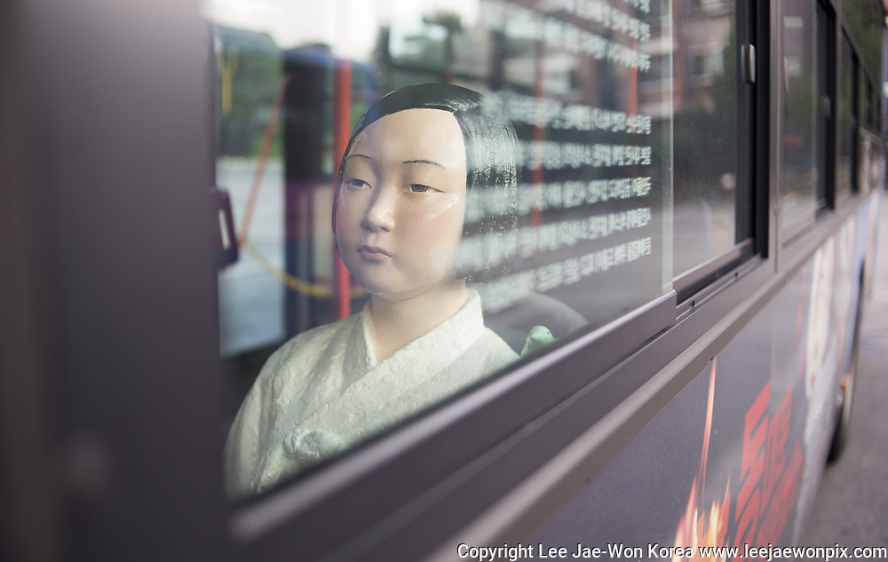The Comfort Women Statue or the Peace Monument symbolizing Korean Comfort Women or sex slaves by Japanese military during the Second World War, is seen installed in a bus in Seoul, South Korea, Aug 17, 2017. Five blue buses numbered 151 in Seoul run from August 14 - September 30, 2017, carrying the peace monuments to mark the memorial day for the victims which falls on August 14, 2017. Photo by Lee Jae-Won (SOUTH KOREA) www.leejaewonpix.com