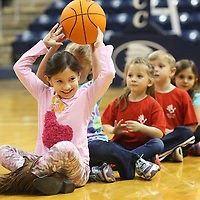 Lauren Wood | Buy at photos.djournal.com<br /> Azucena Lopez, 7, passes a basketball to her classmate while playing a game of inchworm during Mooreville Elementary School's visit at the ICC-Fulton campus.