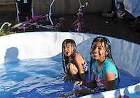 There&rsquo;s always something going on near the Hebron Family Center in Salinas, especially after a wave of different buses let kids out of school for the afternoon. <br /> <br /> For four year-old Norali Perez, on a perfect blue afternoon, there&rsquo;s perhaps the best activity of all, splashing around with her sister Maria, a Loma Vista 5th grader, in a pool filled up just for the occasion.