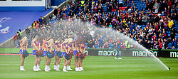 18.10.2014, Selhurst Park Stadium, London, ENG, Premier League, FC Crystal Palace vs FC Chelsea, 8. Runde, im Bild Crystal Palace's cheerleaders the Crystals get a soaking from the water sprinklers // 15054000 during the English Premier League 8th round match between Crystal Palace FC and Chelsea FC at the Selhurst Park Stadium in London, Great Britain on 2014/10/18. EXPA Pictures © 2014, PhotoCredit: EXPA/ Propagandaphoto/ David Rawcliffe<br /> <br /> *****ATTENTION - OUT of ENG, GBR*****