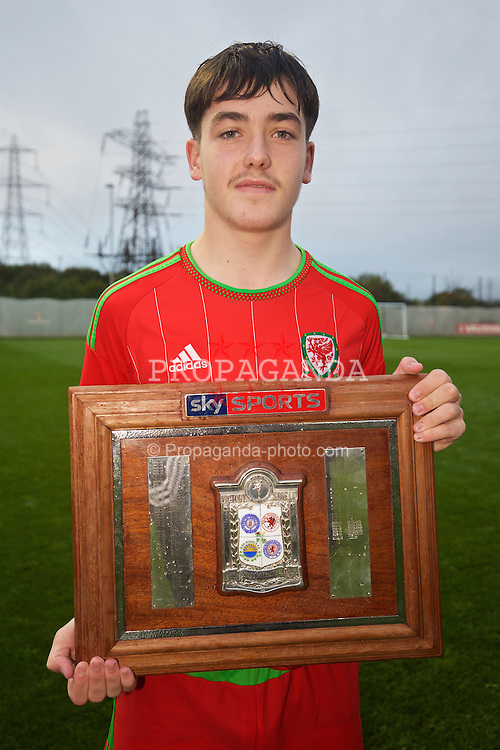NEWPORT, WALES - Thursday, November 5, 2015: Wales' Mathew Jake Nicholls celebrates with the Victory Shield after a 3-1 victory over Northern Ireland during the Under-16's Victory Shield International match at Dragon Park. (Pic by David Rawcliffe/Propaganda)
