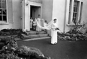 "16/09/1967<br /> 09/16/1967<br /> 16 September 1967<br /> Wedding of Mr Francis W. Moloney, 28 The Stiles Road, Clontarf and Ms Antoinette O'Carroll, ""Melrose"", Leinster Road, Rathmines at Our Lady of Refuge Church, Rathmines, with reception in Colamore Hotel, Coliemore Road, Dalkey. Image shows the bride leaving home before e the ceremony."