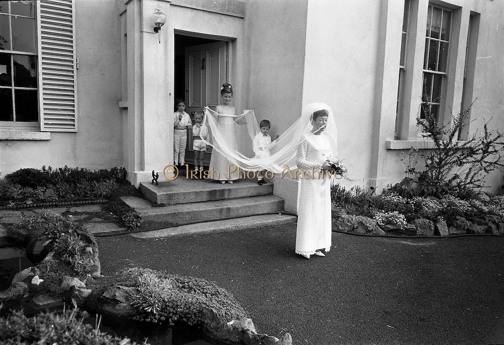 """16/09/1967<br /> 09/16/1967<br /> 16 September 1967<br /> Wedding of Mr Francis W. Moloney, 28 The Stiles Road, Clontarf and Ms Antoinette O'Carroll, """"Melrose"""", Leinster Road, Rathmines at Our Lady of Refuge Church, Rathmines, with reception in Colamore Hotel, Coliemore Road, Dalkey. Image shows the bride leaving home before e the ceremony."""