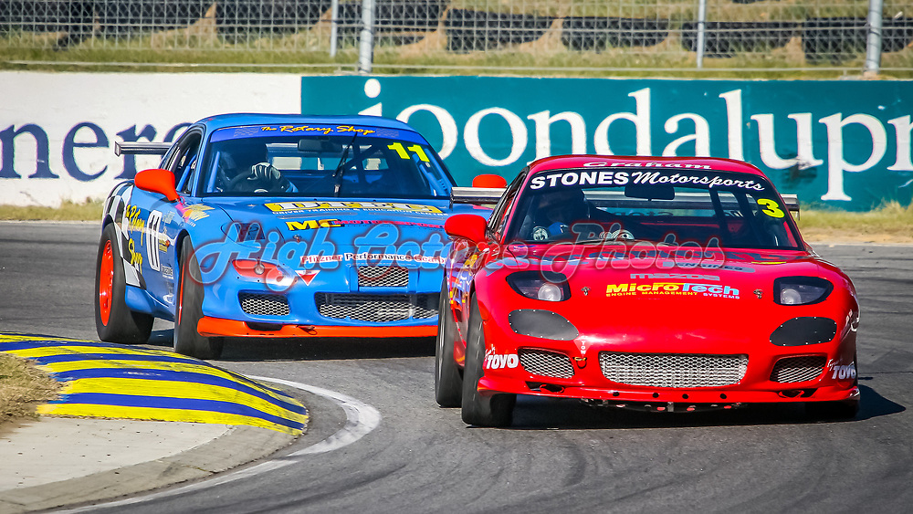 Graham Stones (3 - Mazda RX7) leads Kerry Wade (11 - Mazda RX7) onto the main straight at Wanneroo Raceway.