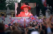 Royalist crowds wave as Queen Elizabeth II appears on a giant screen during her Golden (50th anniversary) Jubilee.