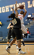 Alana Aguirre #15 of Frisco Wakeland shoots the ball over Taylor Holley #20 of The Colony at Little Elm High School on Friday, February 8, 2013 in Little Elm, Texas. (Cooper Neill/The Dallas Morning News)