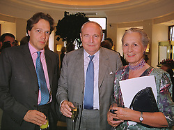 Left to right, the EARL OF MARCH with his parents the DUKE & DUCHESS OF RICHMOND AND GORDON, at a reception in London on 13th July 1999.MUE 26