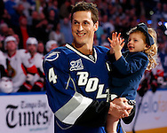 Tampa Bay Lightning's Vincent Lecavalier holds his daughter Victoria during a ceremony honoring his 1000th career NHL game prior to the team's NHL hockey game against the Ottawa Senators in Tampa, Florida January 25, 2013.  REUTERS/Mike Carlson (UNITED STATES)