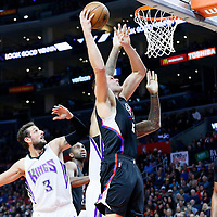 16 January 2016: Los Angeles Clippers center Cole Aldrich (45) goes for the dunk past Sacramento Kings guard Marco Belinelli (3) and on Sacramento Kings center DeMarcus Cousins (15) during the Sacramento Kings 110-103 victory over the Los Angeles Clippers, at the Staples Center, Los Angeles, California, USA.