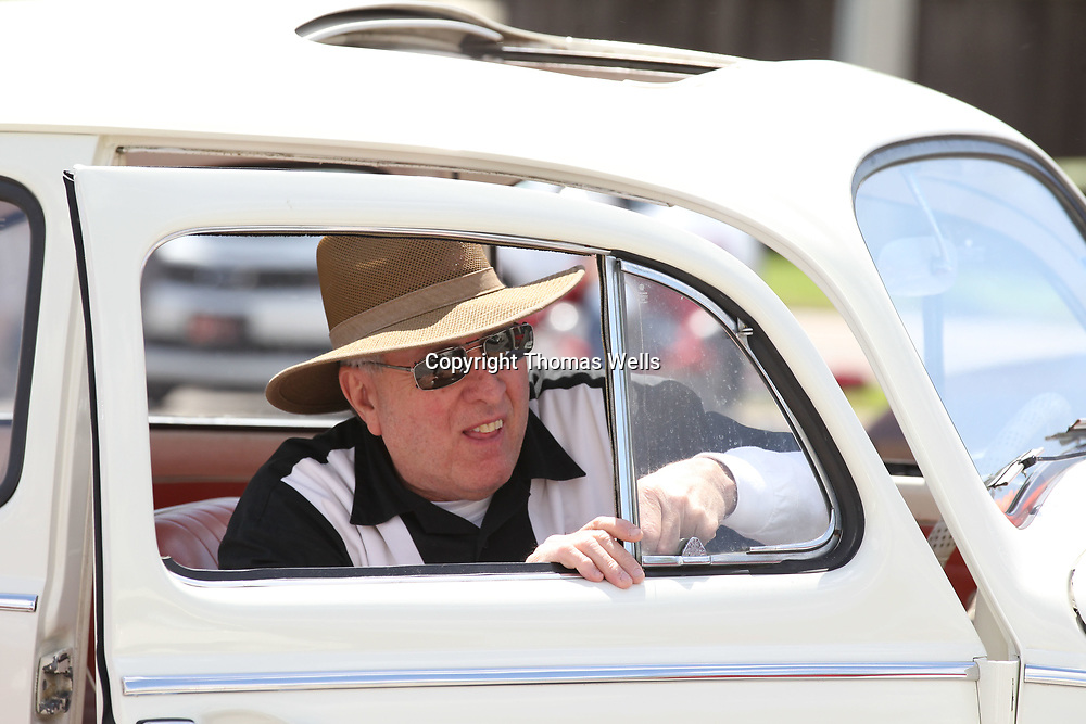"Don Tyra of Mantachie opens the half window of his ""beetle"" that he brought to this year's Blue Suede Cruise on Friday."