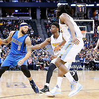 06 March 2016: Dallas Mavericks guard Deron Williams (8) faces Denver Nuggets guard Emmanuel Mudiay (0) and Denver Nuggets forward Kenneth Faried (35) next to Dallas Mavericks forward Dirk Nowitzki (41) during the Denver Nuggets 116-114 overtime victory over the Dallas Mavericks, at the Pepsi Center, Denver, Colorado, USA.