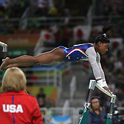 Gymnastics - Olympics: Day 6  Simone Biles #391 of the United States in action watched by her coach Aimee Boorman during her Uneven Bars routine during her gold Medal performance in the Artistic Gymnastics Women's Individual All-Around Final at the Rio Olympic Arena on August 11, 2016 in Rio de Janeiro, Brazil. (Photo by Tim Clayton/Corbis via Getty Images)
