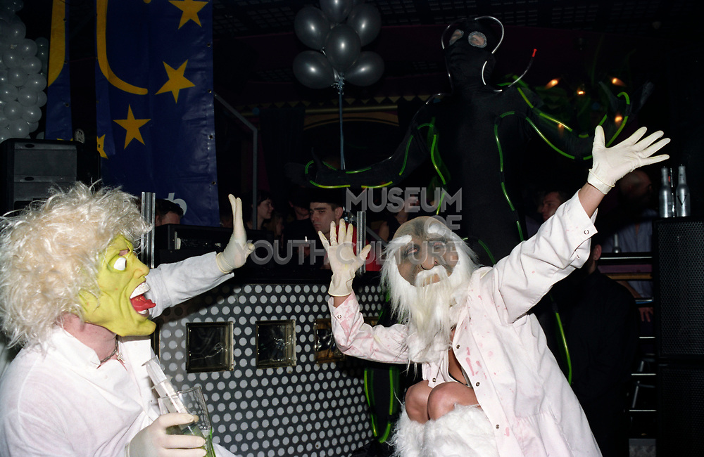 Two clubbers wearing mad professor masks, Club Class, Ikon, Maidstone, Kent, 2002