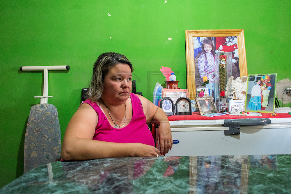 2014/11/18 - Monte Maiz, Argentina: Ant&oacute;nia Alaris (36) sits in her living-room next to an altar in memory to her daughter, Antonella Fuentes, who was diagnosed with osteosarcoma, a cancerous bone tumor, at the age of 6. She died a few months later.  The cases of cancer grew exponentially in the area since the introduction of glyphosate on the soy cultivation.  707 <br /> Cancer cases per 100,000 pepople were register by health researchers in the core area of soybean cultivation. These are three times as many  as the national average. (Eduardo Leal)