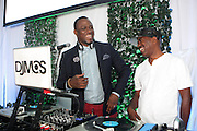 Water Mill, New York:- (L-R) DJ MOS and Recording Artist Kurtis Blow  attends the RUSH Philanthropic Arts Foundation 15th Annual Art For Life Benefit Gala held in the Hamptons at the Farmview Farms on July 26, 2014  in Water Mill, New York. (Terrence Jennings)