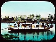 Houseboat on a river in Japan, 1895. Hand-coloured lantern slide.