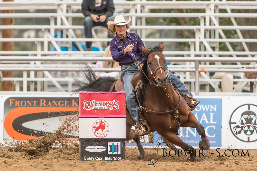 Cheryl Kennedy makes her barrel racing run during slack at the Elizabeth Stampede on Sunday, June 3, 2018.