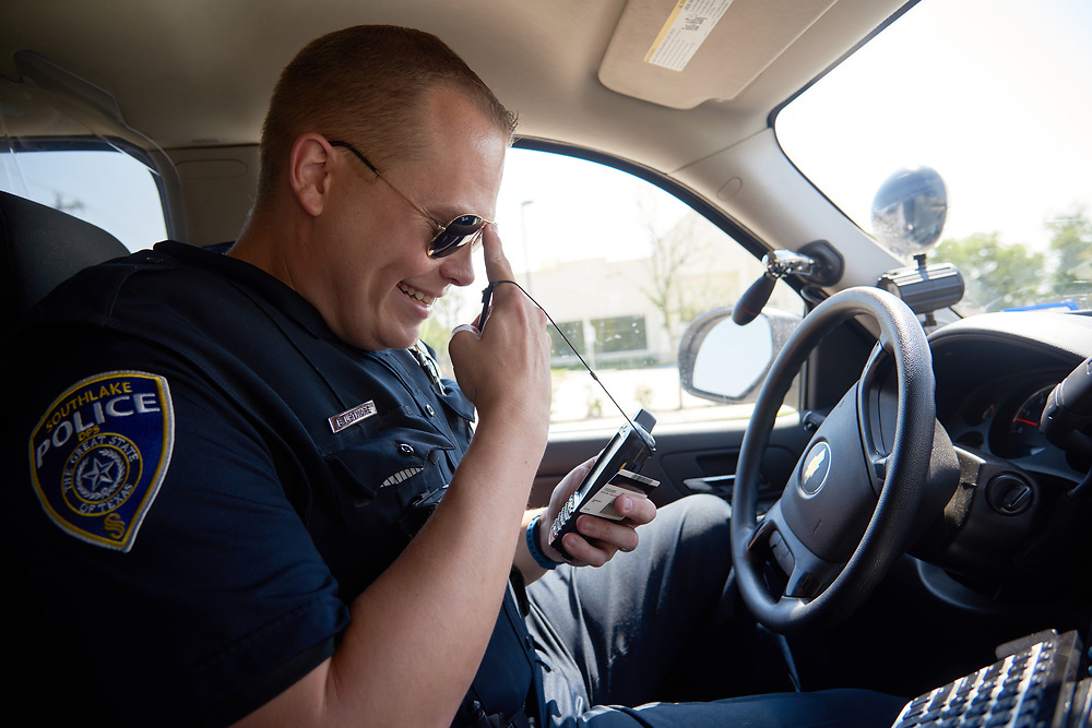 "Officer Brad Uptmore of the Southlake Police Department patrols the streets in Southlake, Texas on June 23, 2017. ""CREDIT: Cooper Neill for The Wall Street Journal""<br /> Police"
