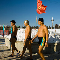 Chinese men participe in the winter swimming festival held in Harbin, northeastern China's Heilongjiang province, Tuesday, Jan. 6, 2009, Photographer: Bernardo De Niz