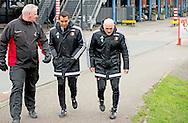 ROTTERDAM - feyenoord coach  Giovanni van Bronckhorst loopt onder begeleiding van een beveiliger samen met  Jan Wouters naar het trainingsveld varkensoord . copyright robin utrecht