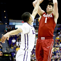Jan 14, 2017; Baton Rouge, LA, USA; Alabama Crimson Tide guard Riley Norris (1) shoots over LSU Tigers guard Skylar Mays (4) during the first half of a game at the Pete Maravich Assembly Center. Mandatory Credit: Derick E. Hingle-USA TODAY Sports