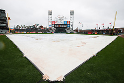 SAN FRANCISCO, CA - APRIL 09:  General view of AT&T Park with a tarp covering the infield during a rain shower before the game between the San Francisco Giants and the Los Angeles Dodgers on April 9, 2016 in San Francisco, California.  (Photo by Jason O. Watson/Getty Images) *** Local Caption ***