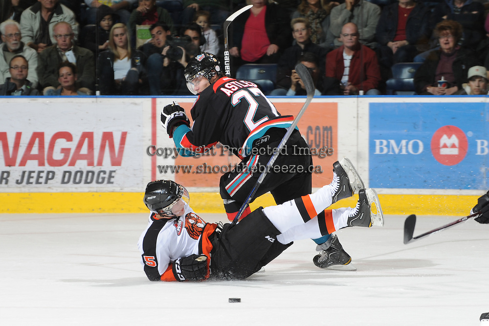 KELOWNA, CANADA, OCTOBER 11: Jessey Astles #27 of the Kelowna Rockets checks Tyler Lewington #5 of the Medicine Hat Tigers as the Medicine Hat Tigers visited the Kelowna Rockets on October 11, 2011 at Prospera Place in Kelowna, British Columbia, Canada (Photo by Marissa Baecker/shootthebreeze.ca) *** Local Caption ***Jessey Astles;Tyler Lewington;