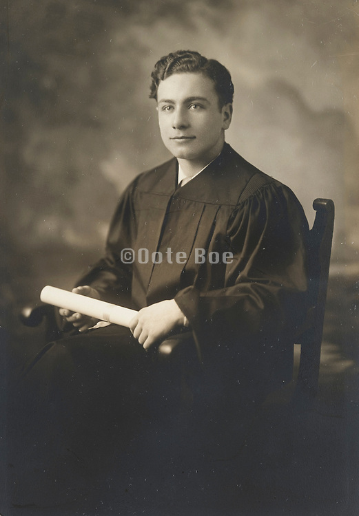 A young man formal portrait after receiving his university degree.
