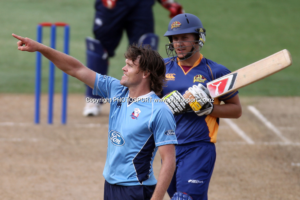 Lou Vincent shows Neil Wagner where to go during the semi final ODI playoff match, Auckland Aces v Otago Volts. Colin Maiden Park, Auckland. Wednesday 9 February 2011. Photo: Ella Brockelsby/photosport.co.nz