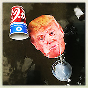 After the rally, a spilled soda and Trump mask.<br /> <br /> Donald Trump's primary rally in West Virginia's state capital at the Charleston Civic Center. After Cruz and Kasich bowed out of the race for the Republican Party, Trump, the presumptive Republican election candidate was in West Virginia celebrating a victory lap.<br /> Trump has promised to re-open closed coal mines and get miners back to work, a very popular platform in this coal state which is one of the nation's poorest.