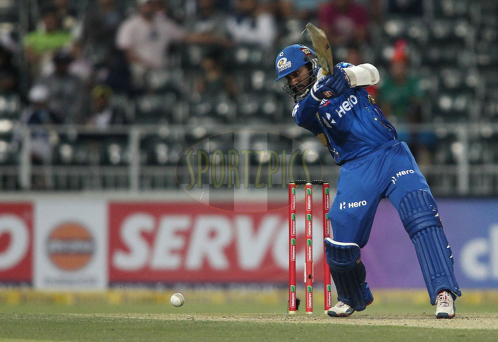 Dinesh Karthik of the Mumbai Indians attacks a delivery during match 4 of the Karbonn Smart CLT20 South Africa between The Highveld Lions and The Mumbai Indians held at The Wanderers Stadium in Johannesburg, South Africa on the 14th October 2012..Photo by Shaun Roy/SPORTZPICS/CLT20