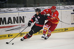 04.01.2015, Arena Nuernberger Versicherung, Nuernberg, GER, DEL, Thomas Sabo Ice Tigers Nuernberg vs Duesseldorfer EG, 35. Runde, im Bild Trikotnr.: 21 Drew Schiestel - Duesseldorfer EG (rotes Trikot) vs. Trikotnr.: 33 Fredrik Eriksson - Ice Tigers Nuernberg (schwarzes Trikot) // during Germans DEL Icehockey League 35th round match between Thomas Sabo Ice Tigers Nuernberg and Duesseldorfer EG at the Arena Nuernberger Versicherung in Nuernberg, Germany on 2015/01/04. EXPA Pictures © 2015, PhotoCredit: EXPA/ Eibner-Pressefoto/ Arth<br /> <br /> *****ATTENTION - OUT of GER*****