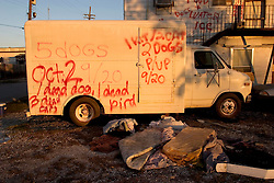 21December 05. New Orleans, Louisiana.  Post Katrina aftermath.<br /> Rescue workers graffiti lingers on trucks, cars and walls of the devastated 9th Ward long after the devastating flood from Hurricane Katrina subsided. <br /> Photo; ©Charlie Varley/varleypix.com