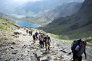 © Licensed to London News Pictures. 17/05/2014. Capel Curig, UK Walkers climb Snowdon in warm sunshine in North Wales today 17th May 2014. Photo credit : Stephen Simpson/LNP