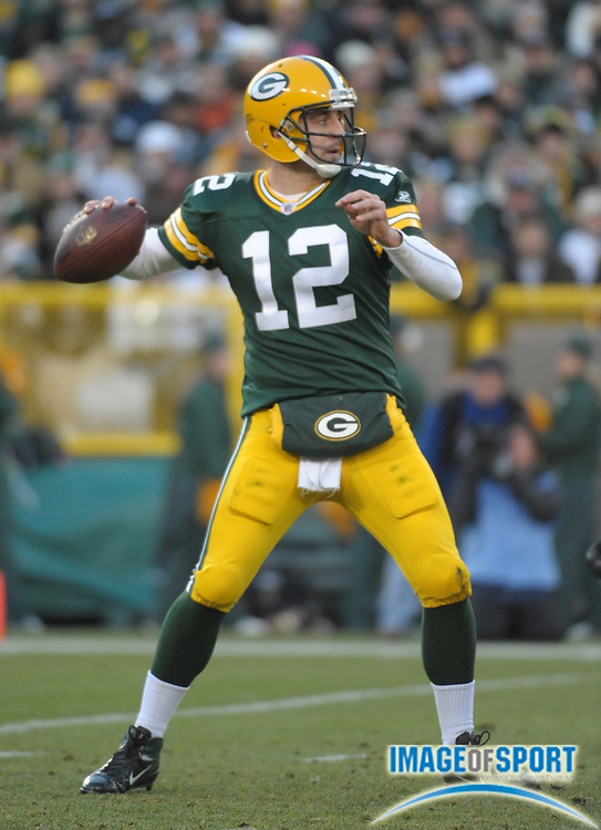 Dec 11, 2011; Green Bay, WI, USA; Green Bay Packers quarterback Aaron Rodgers (12) throws a pass against the Oakland Raiders at Lambeau Field.
