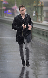 © Licensed to London News Pictures. 29/05/2018. London, UK. A man runs across Westminster Bridge just as thunderstorms bring heavy rain to the capital.  Photo credit: Peter Macdiarmid/LNP